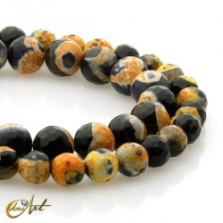 Faceted orange and black agate beads