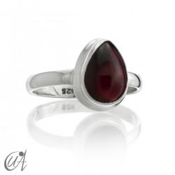 Silver and garnet, ring tear model