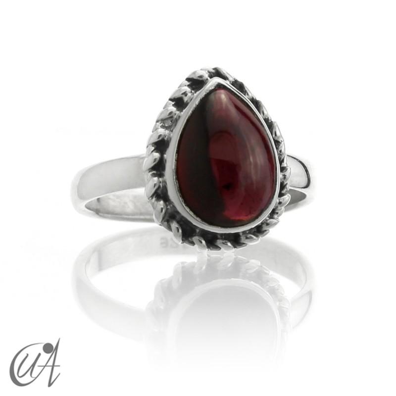 Garnet drop ring in sterling silver