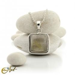 Quadrangular pendant of sterling silver and quartz with rutile