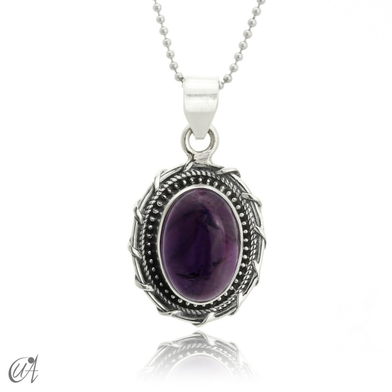 Silver and amethyst pendant, Maktub