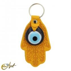 Ojo turco con mano de Fátima - llavero color amarillo