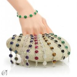 Silver bracelet with round gemstones