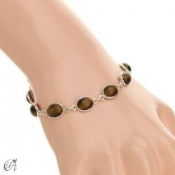 Silver bracelet with oval stones - tiger eye