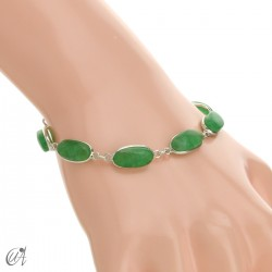 Oval bracelet, sterling silver with green sapphire