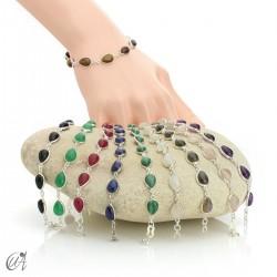 Silver bracelet and teardrop-cut stones