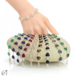 Silver bracelet and gems, threshing