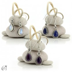 Linked drop earrings in silver and stones