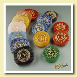 Kit with 7 engraved flat stones for chakra balancing.